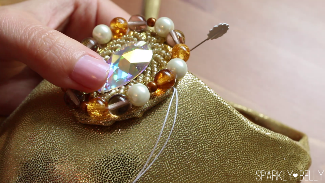 Apply applique to costume bra sparkly belly